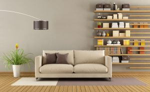 Contemporary living room with sofa and minimalist bookcase - 3D Rendering