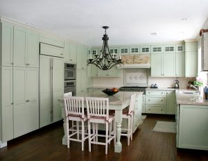 Country style pistachio painted kitchen with island