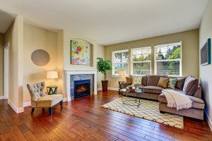 Cozy living room interior with fireplace beige walls and hardwood floor. Northwest USA