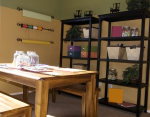 an arts and crafts room with various supplies.